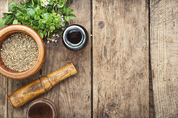 Fresh and dried oregano herb - Stock Photo - Images