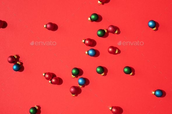 Christmas pattern made of colorful christmas baubles - Stock Photo - Images