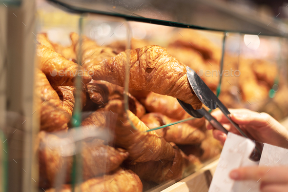 Girl choosing pastry in supermarket. Copy space. Healthy diet concept. Sustainable lifestyle. - Stock Photo - Images