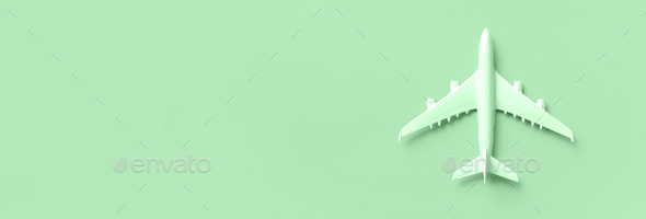 White plane, airplane on trendy mint color background with copy space. Top view, flat lay. Minimal - Stock Photo - Images