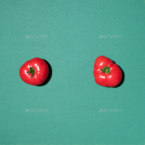 Red tomatoes pattern on green background. Flat lay, top view. Summer minimal concept. Vegan and - Stock Photo - Images