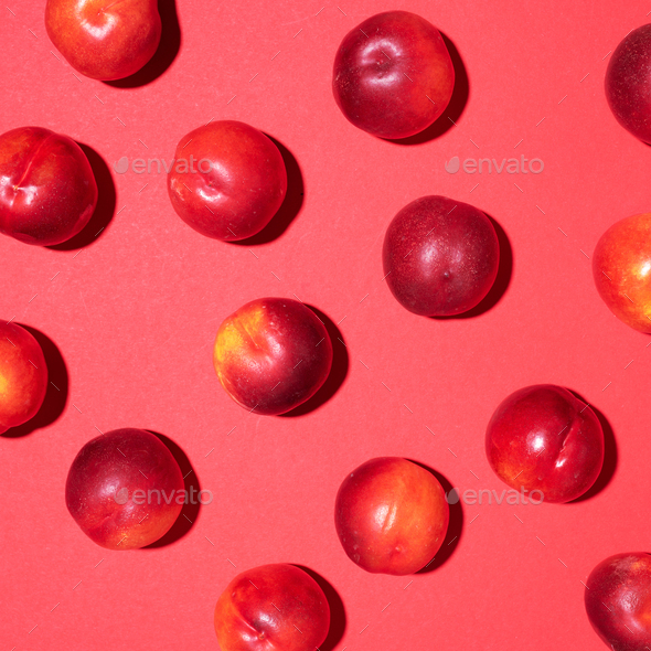 Nectarines pattern on red background. Frame made of fresh fruits. Flat lay, top view, copy space - Stock Photo - Images