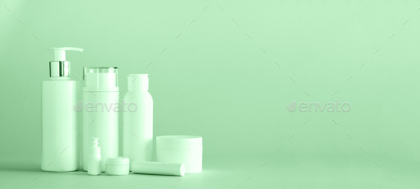 White cosmetic tubes on trendy mint color background with copy space. Skin care, body treatment - Stock Photo - Images