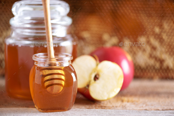 Apples with honey jar, honeycomb on grey background with copy space. Rosh hashanah jewish new year - Stock Photo - Images