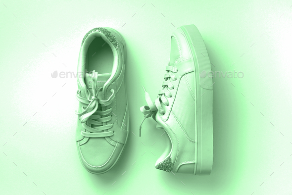 White leather sneakers on mint background. Pair of fashion trendy white sport shoes or sneakers with - Stock Photo - Images