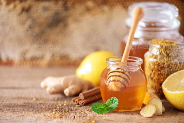 Alternative medicine concept. Ingredients for flu fighting natural hot drink. Copy space. Lemon - Stock Photo - Images