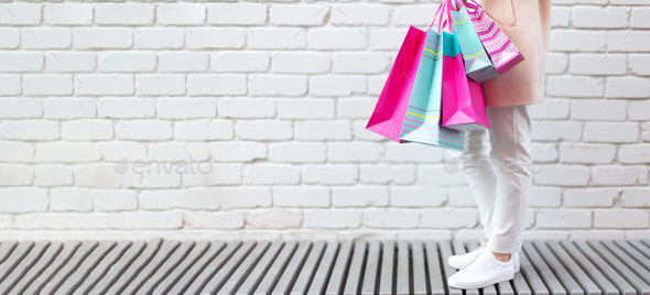 Stylish Girl In White Clothes Holding Pink Shopping Bags Sale Discount Black Friday Concept Stock Photo By Jchizhe