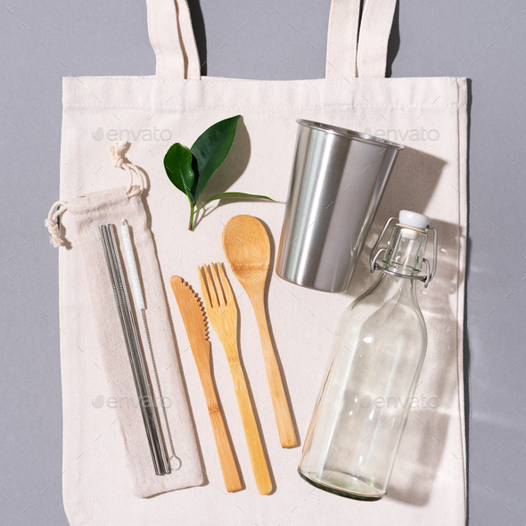 Fabric bags, glass jars, metal straws, bamboo cutlery on grey background with copy space. Eco - Stock Photo - Images