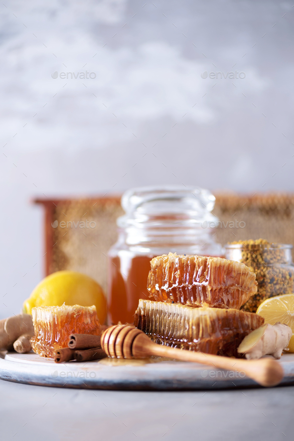 Ingredients for healthy hot drink. Lemon, ginger, mint, honey, apple and spices on grey background - Stock Photo - Images
