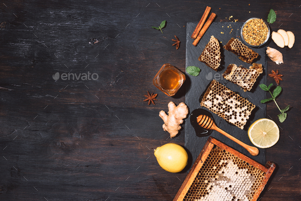 Ingredients for healthy hot drink. Lemon, ginger, mint, honey, apple and spices on black slate tray - Stock Photo - Images