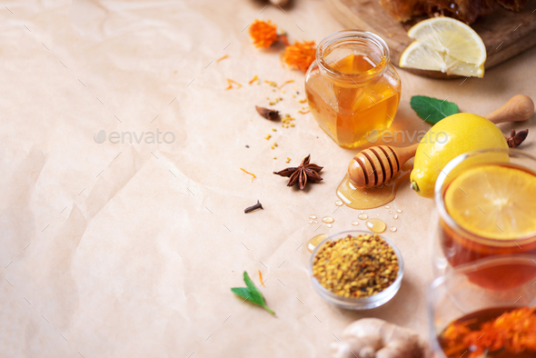 Autumn harvest concept. Set of honey and bee products, apple, lemon, spices on craft paper - Stock Photo - Images
