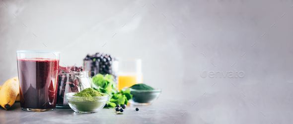 Heavy metals detox smoothie. Blueberries, bilberry, barley grass juice extract, spirulina powder - Stock Photo - Images