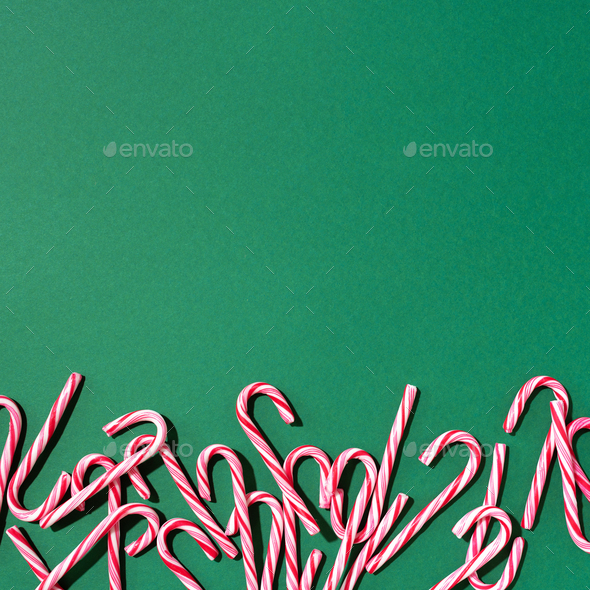 Christmas candy canes on green background. Top view. Flat lay. Creative minimal concept. Greeting - Stock Photo - Images