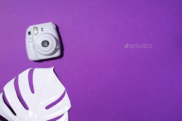 Vilnius, Lithuania - September 16, 2019: FUJIFILM INSTAX Mini Instant Film Camera on violet - Stock Photo - Images