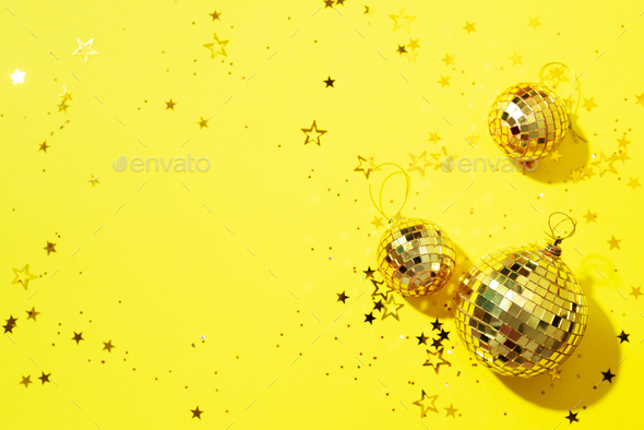 Creative Christmas concept. Shiny gold disco balls over yellow background. Flat lay, top view. New - Stock Photo - Images