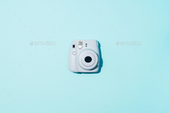 Vilnius, Lithuania - September 16, 2019: FUJIFILM INSTAX Mini Instant Film Camera on blue background - Stock Photo - Images