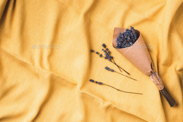 Dry lavender flowers on yellow fabric texture background. top view. Flat lay. Free space for text or - Stock Photo - Images