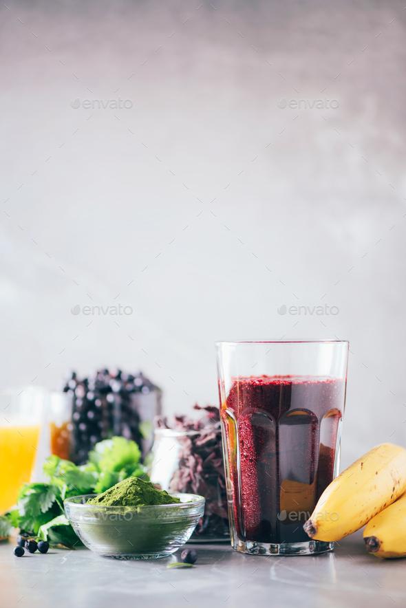 Fresh blueberries, bilberry, barley grass juice, spirulina, orange juice, dulse and cilantro on - Stock Photo - Images