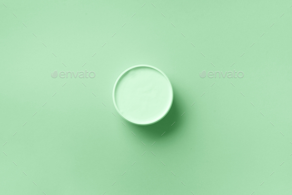 Body butter jar on in trendy mint color background with copy space. Skin care product, natural - Stock Photo - Images