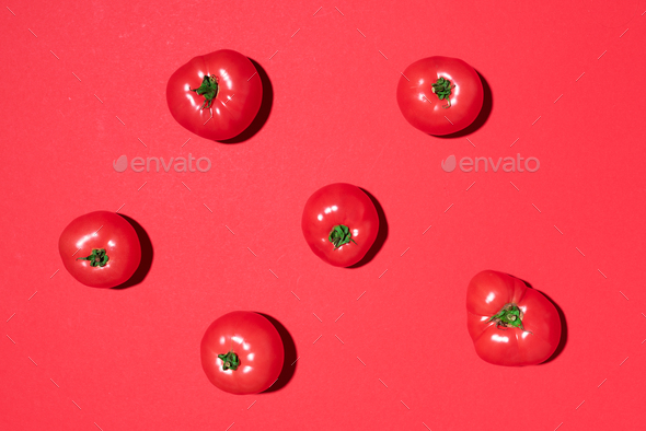 Red tomatoes pattern on red background. Flat lay, top view. Summer minimal concept. Vegan and - Stock Photo - Images