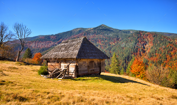 Beautiful landscape with old wooden hut in the Carpathians mount - Stock Photo - Images