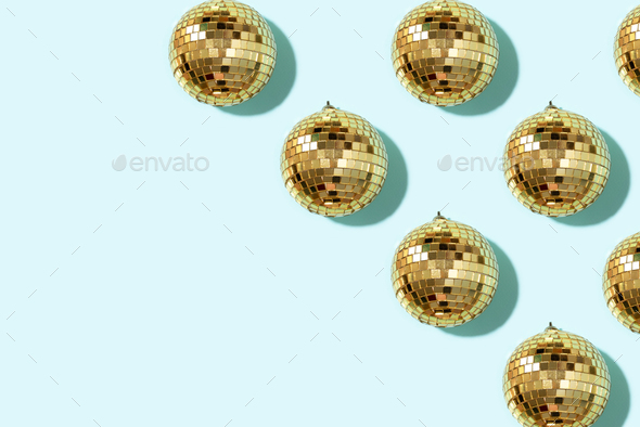 Christmas gold baubles organized on blue background. Top view. Flat lay. Creative New year pattern - Stock Photo - Images