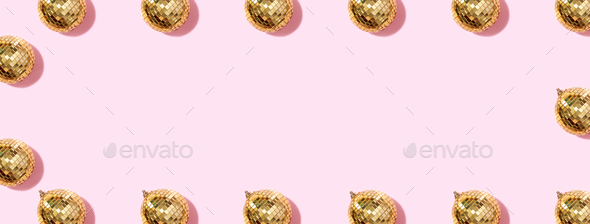 Creative Christmas pattern. Frame with shiny gold disco balls over pink background. Flat lay, top - Stock Photo - Images