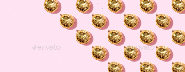 New year baubles. Shiny gold disco balls on pink background. Pop disco style attributes, retro - Stock Photo - Images