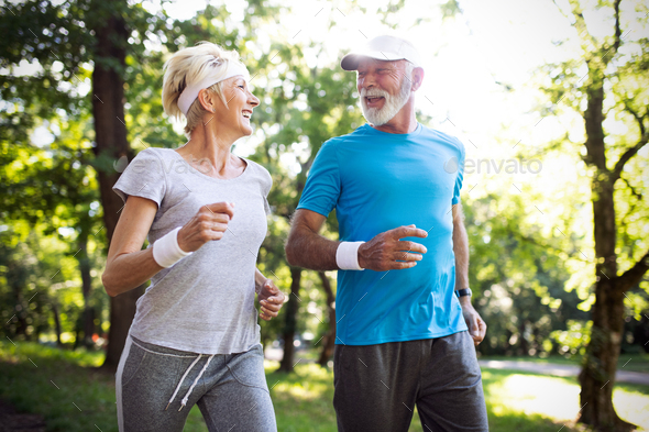 Happy mature people couple exercising for healthy life - Stock Photo - Images