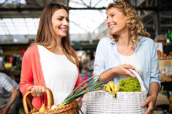 Young women shopping on the market healthy vegetables and fruits - Stock Photo - Images