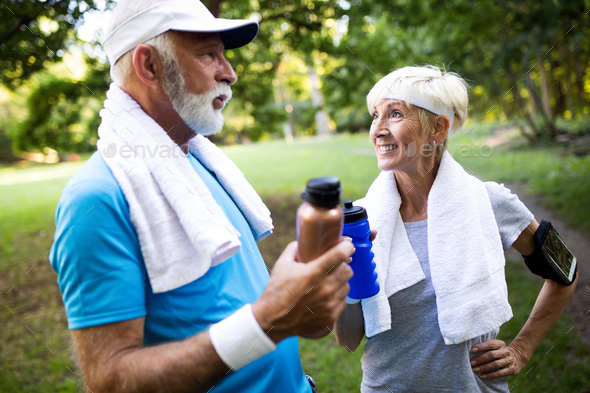 Beautiful mature couple jogging in nature living healthy - Stock Photo - Images