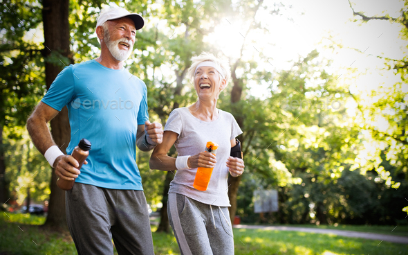 Active senior couple engaging in healthy sports activies - Stock Photo - Images