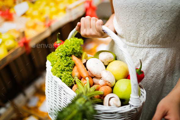 Beautiful women shopping vegetables and fruits on the market - Stock Photo - Images