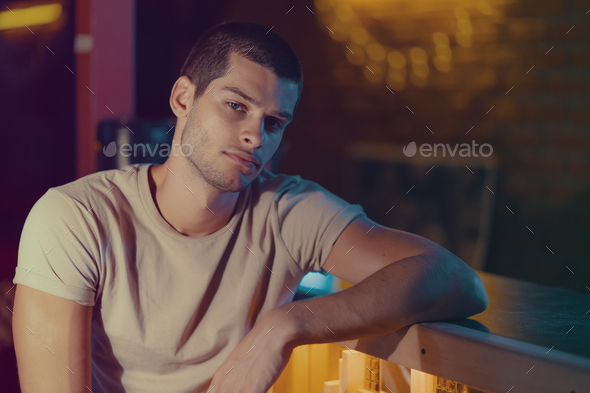 Close-up portrait of attractive male model. Young handsome man in a bar - Stock Photo - Images