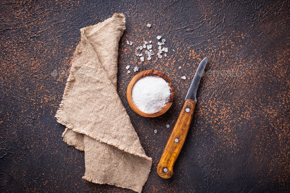 Culinary background with salt and knife - Stock Photo - Images