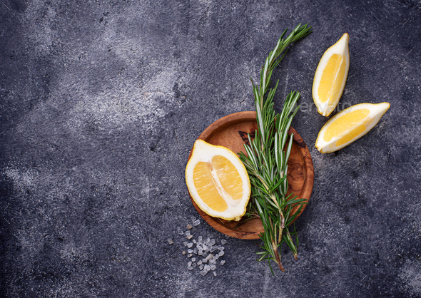 Rosemary, lemon and salt. Traditional spices for fish - Stock Photo - Images