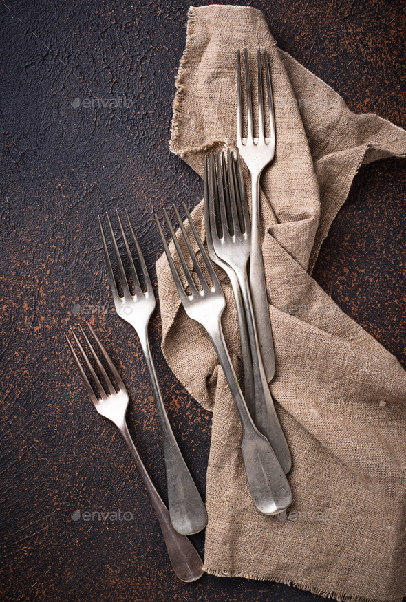 Vintage forks on rusty background - Stock Photo - Images