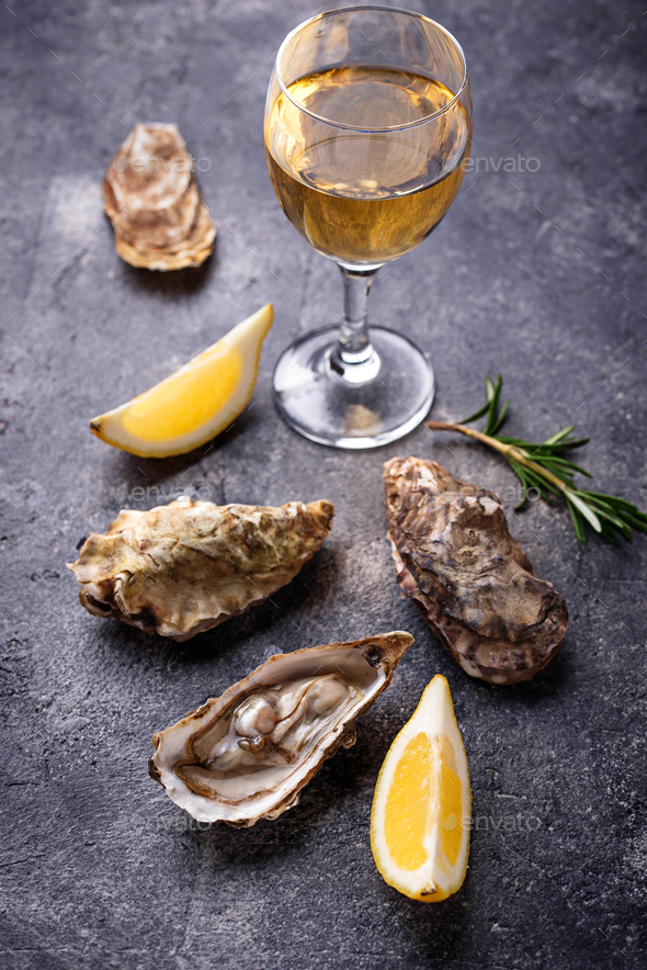 Fresh oysters with lemon and white wine - Stock Photo - Images