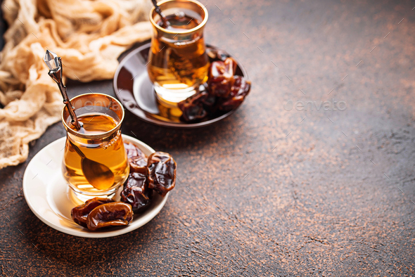 Traditional arabic tea and dry dates - Stock Photo - Images