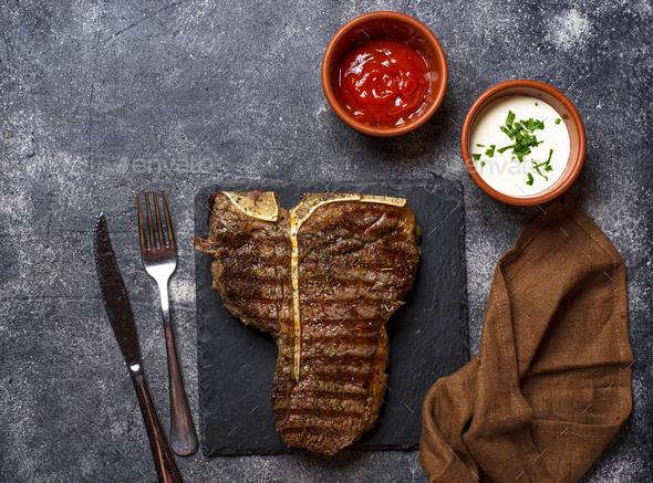 Grilled T-bone steak on dark background - Stock Photo - Images