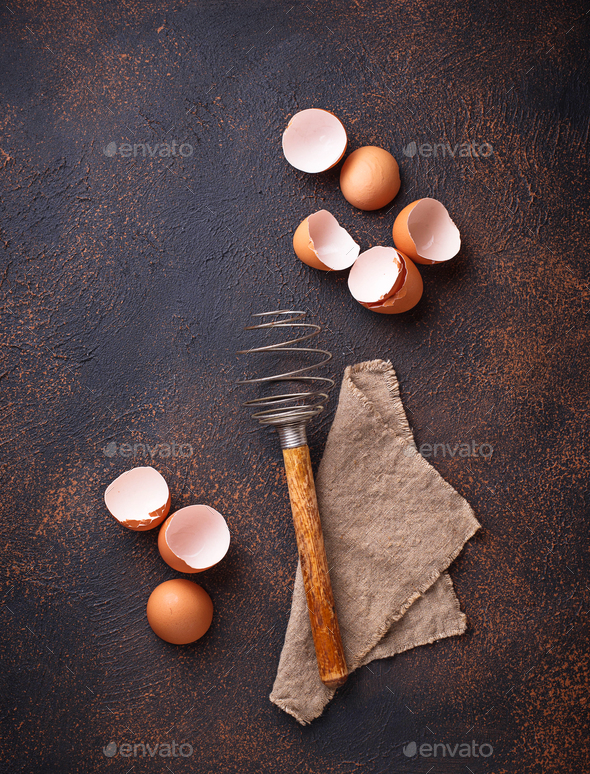 Eggshell and old  vintage whisk - Stock Photo - Images