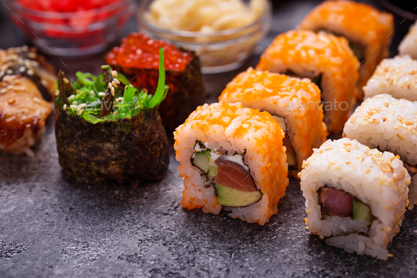 Sushi and roll set on black table - Stock Photo - Images