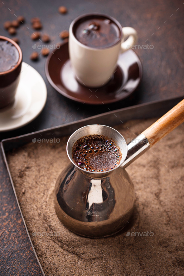 Traditional turkish coffee prepared on hot sand - Stock Photo - Images