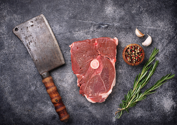 Lamb meat with rosemary, spices and cleaver. - Stock Photo - Images