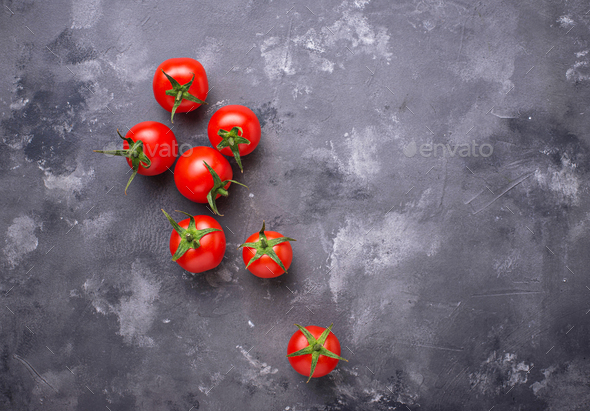 Fresh cherry tomatoes on grey table - Stock Photo - Images
