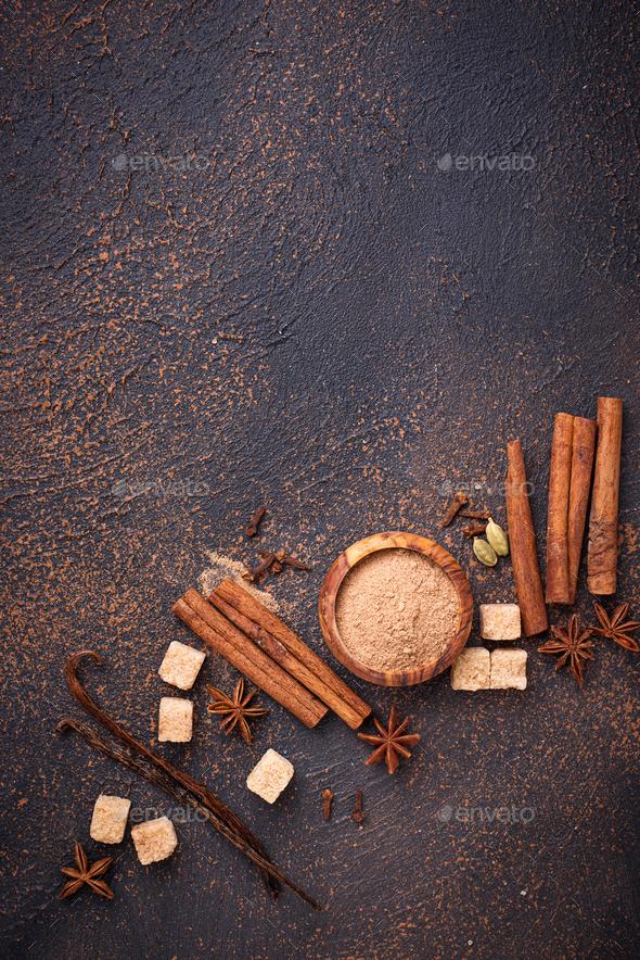 Cinnamon, anise, cardamom, clover and sugar - Stock Photo - Images