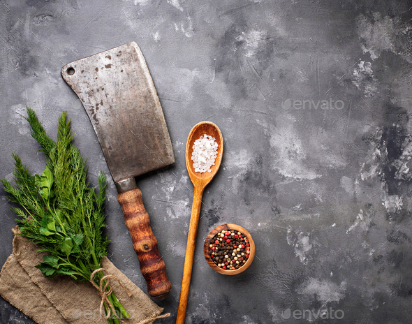 Butchers vintage cleaver with spices - Stock Photo - Images