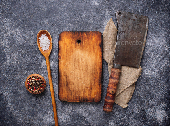 Culinary background with spices, cutting board and hatchet - Stock Photo - Images