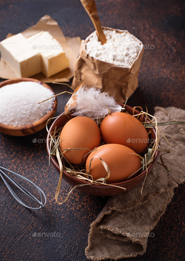 Ingredients for baking. Butter, eggs, sugar and flour - Stock Photo - Images