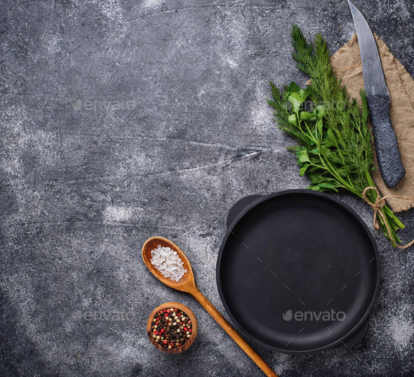 Culinary background with spices, pan and knife - Stock Photo - Images